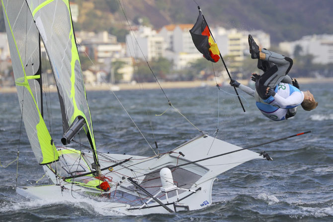 Erik Heil of Germany and team-mate Thomas Ploessel celebrate their bronze medal win in the Men's Skiff - 49er sailing event on August 18