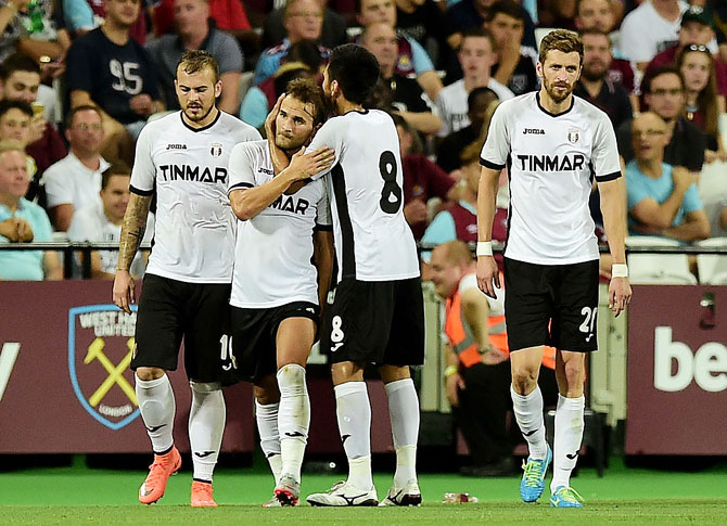 Filipe Teixeira of FC Astra Giurgiu celebrates with teammates after scoring the opening goal against West Ham United during their UEFA Europa League match at the Olympic Stadium in London on Thursday