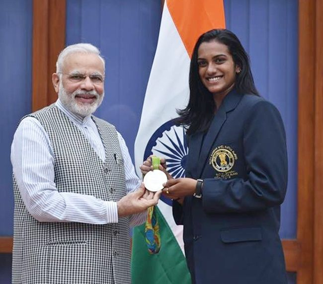 PV Sindhu with Prime Minister Narendra Modi after winning a silver medal at the 2016 Rio Olympics