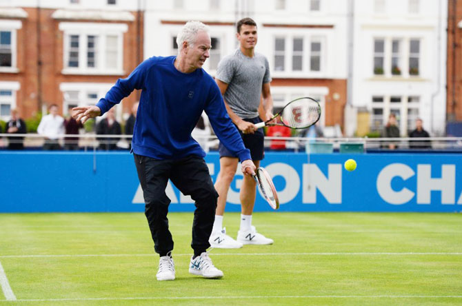 US tennis great John McEnroe and Canada's Milos Raonic during a practice session