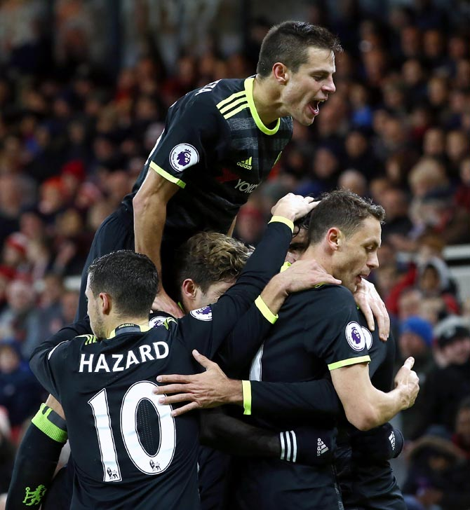 High-flying Chelsea face tough test at Man City