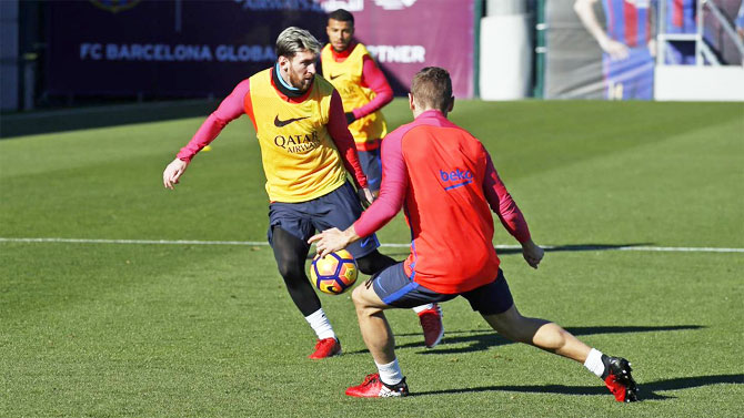 FC Barcelona's Lionel Messi trains during a practice session in Barcelona on Friday