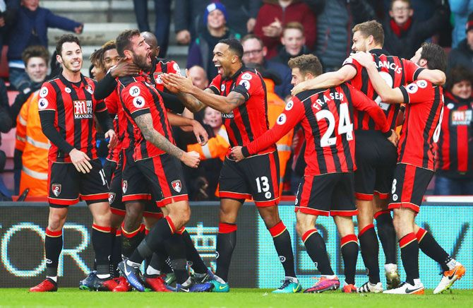 AFC Bournemouth's Steve Cook (3rd from left) celebrates with teammates as he scores their third goal against Liverpool during their English Premier League match at Vitality Stadium in Bournemouth on Sunday
