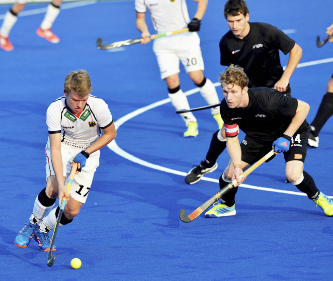 Germany's Ole Thies Prinz is prevented by New Zealand players during their match at Jr. World Cup Hockey Tournament at Major Dhyanchand Stadium in Lucknow on Friday