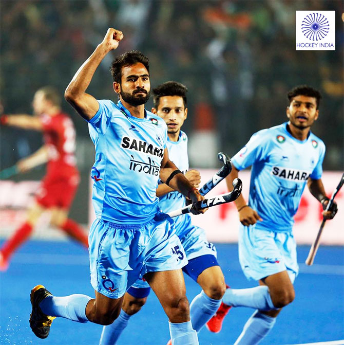 India's Gurjant Singh celebrates on scoring the opening goal against Belgium