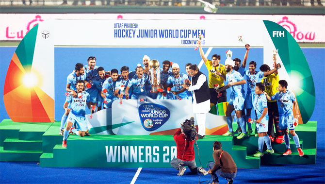 The triumphant Indian junior hockey team with the trophy after winning the Junior Hockey World Cup in Lucknow on Sunday
