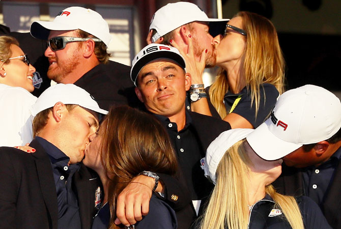 Rickie Fowler of the United States wears a funny look as J.B. Holmes, Erica Holmes, Jimmy Walker, Erin Walker, Jordan Spieth, Annie Verret, Justine Reed and Patrick Reed celebrate during singles matches of the 2016 Ryder Cup at Hazeltine National Golf Club in Chaska, Minnesota, on October 2