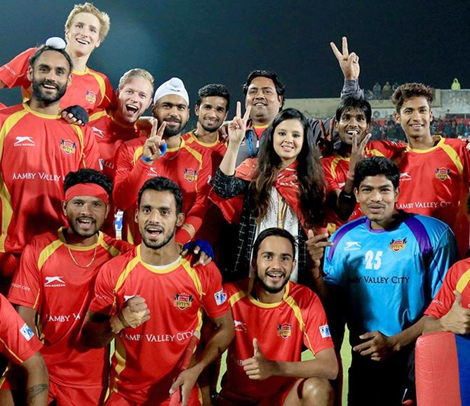 PIX: After cricket and football, hockey gets Sakshi Dhoni's