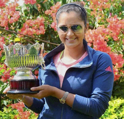 Sania Mirza poses with her Australian Open womens doubles trophy in Hyderabad