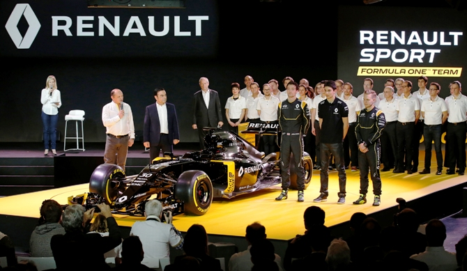Renault Chief Executive Carlos Ghosn (second left), Formula One racing driver Kevin Magnussen of Denmark (right)