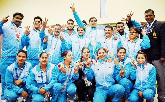 The Indian contingent poses for a group photograph after the end of Weightlifting events at the 12th South Asian Games in Guwahati on Tuesday