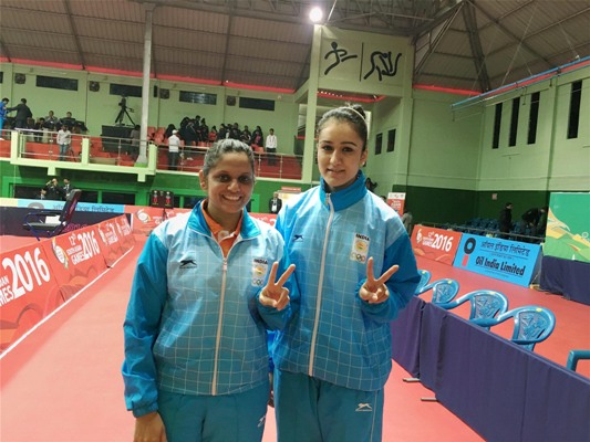 Pooja Sahasrabudhe and Manika Batra showing victory sign after winning gold medal in the women's doubles table tennis event