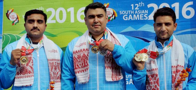 Gold medal winner Chain Singh, with compatriots Gagan Narang and Surendra Singh Rathore
