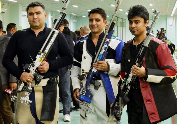 Gold medalist Chain Singh (centre) of India, and bronze medalist Gagan Narang (left)