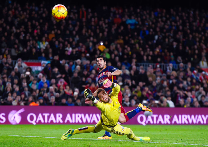FC Barcelona's Luis Suarez scores his team's second goal past Celta Vigo's 'keeper Sergio Alvarez during their La Liga match at Camp Nou in Barcelona on Sunday