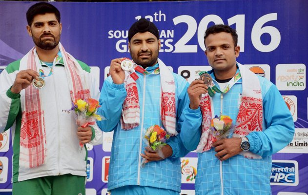 Gold medal winner Gurpreet Singh (center)