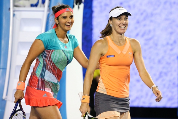 Martina Hingis of Switzerland and Sania Mirza of India react during a match at the Australian Open