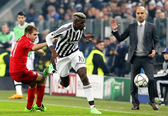 Paul Pogba (right) of Juventus competes for the ball with Philipp Lahm of FC Bayern Muenchen