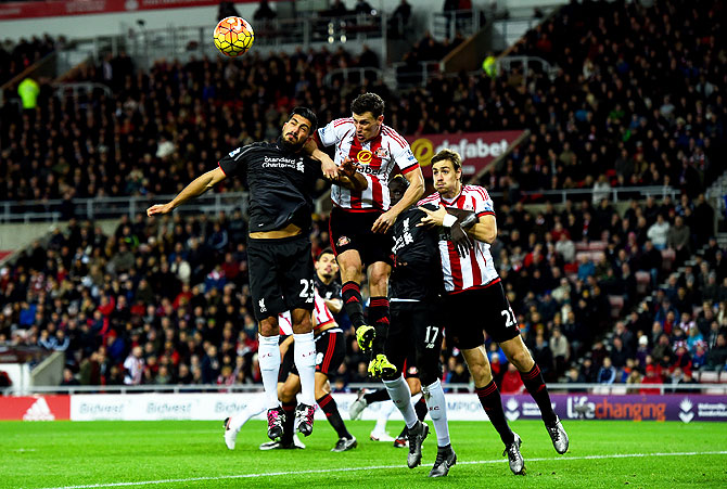 Liverpool's Emre Can and Mamadou Sakho involved in an aeriel challenge against Sunderland's Billy Jones and Sebastian Coates during their Barclays English Premier League match at Stadium of Light in Sunderland on December 30, 2015