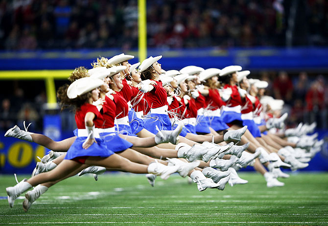 Dancers perform prior to the Goodyear Cotton Bowl between the Alabama Crimson Tide and the Michigan State Spartans at AT&T Stadium in Arlington, Texas, on Thursday, December 31, 2015