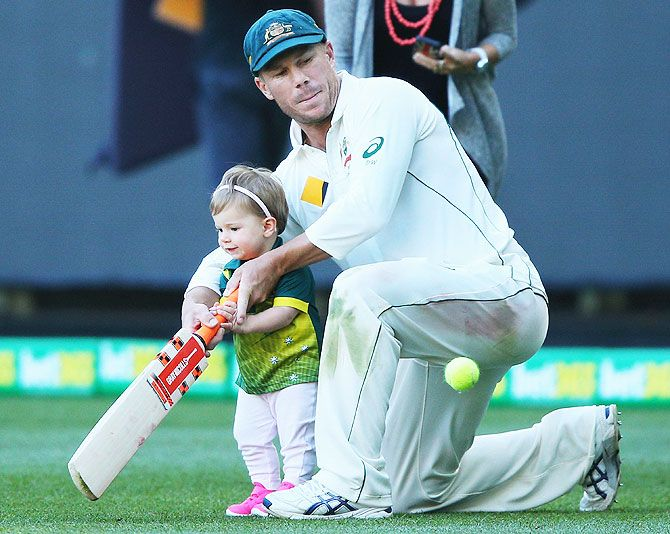 Australia's David Warner plays with his daughter Ivy on Day 4 of the Second Test match between Australia and the West Indies at Melbourne Cricket Ground on December 29, 2015
