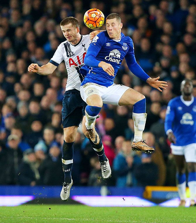 Everton's Ross Barkley and Tottenham Hotspur's Eric Dier are involved in an aeriel challenge