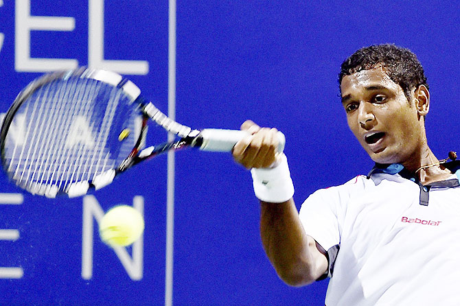 India's Ramkumar Ramanathan in action against Spain Gimeno Traver during their first round match at the ATP Chennai Open 2016 on Tuesday