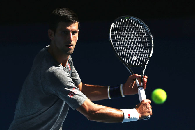 Novak Djokovic of Serbia hits a backhand volley during a practice session ahead of the 2016 Australian Open at Melbourne Park on Sunday