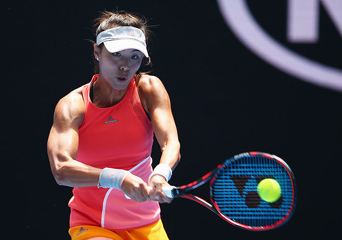 China's Qiang Wang plays a backhand in her first round match against USA's Sloane Stephens