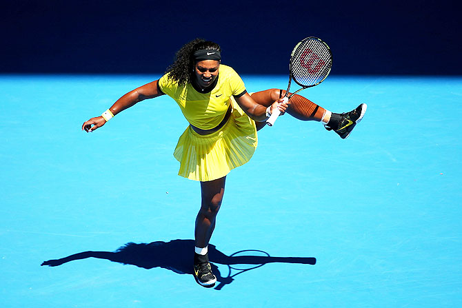 USA's Serena Williams plays a shot in her first round match against Italy's Camila Giorgi in their first round match of the 2016 Australian Open at Melbourne Park on Monday