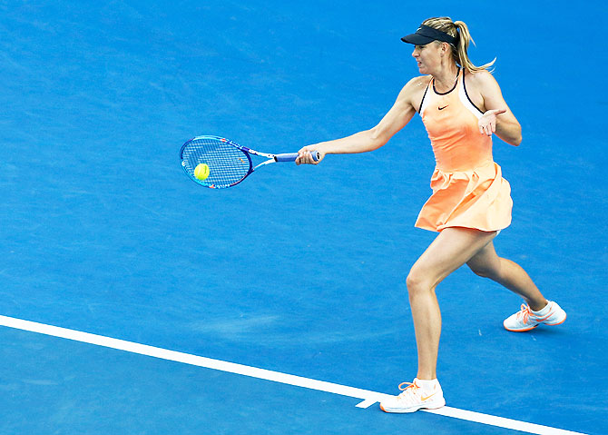 Russia's Maria Sharapova plays a forehand in her first round match against Japan's Nao Hibino