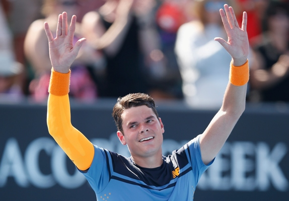 Milos Raonic of Canada celebrates winning his second round match against Tommy Robredo of Spain