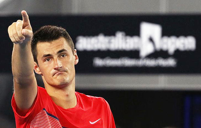 Davis Cup captain Hewitt accuses Tomic of 'threats, blackmail'