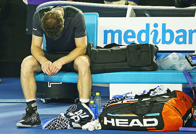 Andy Murray of Great Britain reacts after winning his fourth round match against Bernard Tomic of Australia on Monday