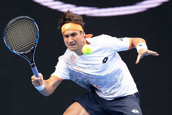 Spain's David Ferrer plays a forehand during his fourth round match against USA's John Isner