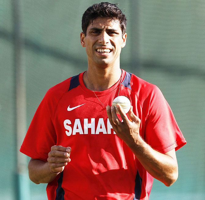 India's Ashish Nehra prepares to bowl in the nets during a practice session