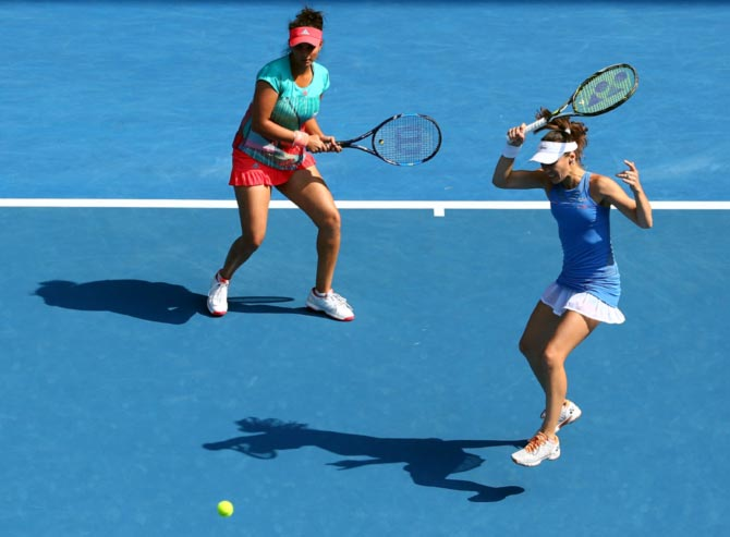 Sania Mirza (left) and Martina Hingis in action