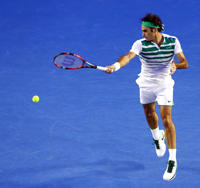 : Roger Federer in action. Photograph: Michael Dodge/Getty Images