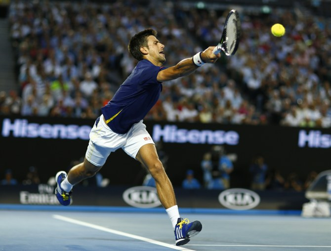 Novak Djokovic in action during his semi-final match against Roger Federer at the Australian Open. Photograph: Thomas Peter/Reuters