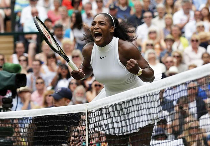 Serena Williams celebrates winning the first set in the 2016 Wimbledon women's singles final against German Angelique Kerber on Saturday