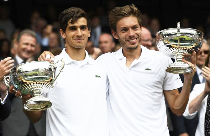 France's Pierre-Hugues Herbert and Nicolas Mahut celebrate winning their men's doubles final against compatriots Julien Benneteau and Edouard Roger-Vasselin at the All England Lawn Tennis & Croquet Club, Wimbledon, on Saturday