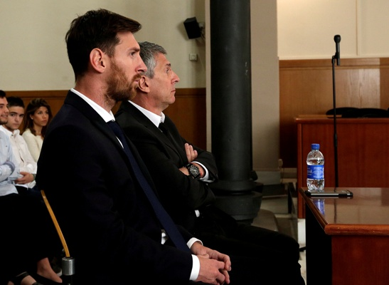 Lionel Messi (left) sits in court with his father Jorge Horacio Messi during their trial for tax fraud in Barcelona