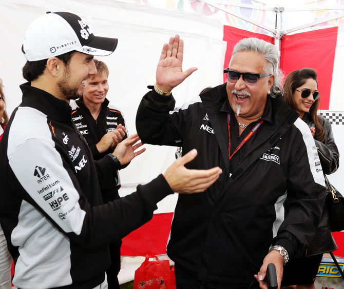Sahara Force India F1 team owner Vijay Mallya, right, with Sergio Perez