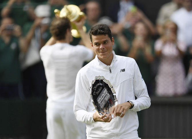 Canada's Milos Raonic with the Wimbledon runner-up trophy
