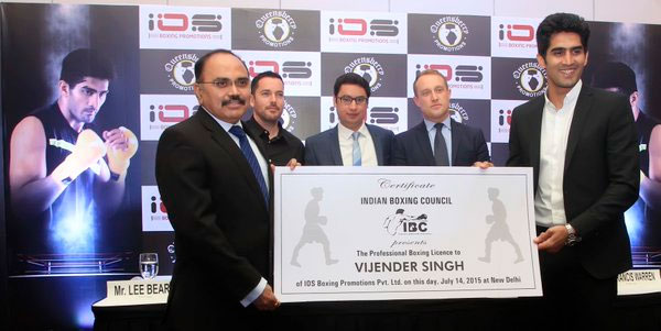 Indian Boxing Council's founder P K Muralidharan Raja offers Vijender Singh his first Pro Boxing License in Delhi on July 14, 2015