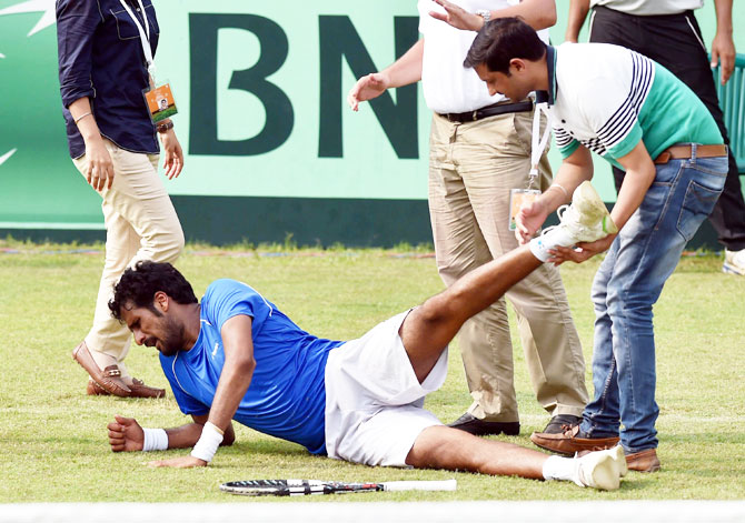 India's Saketh Myneni receives treatment after sustaining an injury during his Davis Cup singles match against Korea's Yong- Kyu Lim at the Asia/Oceania Group-I tie at Chandigarh on Friday