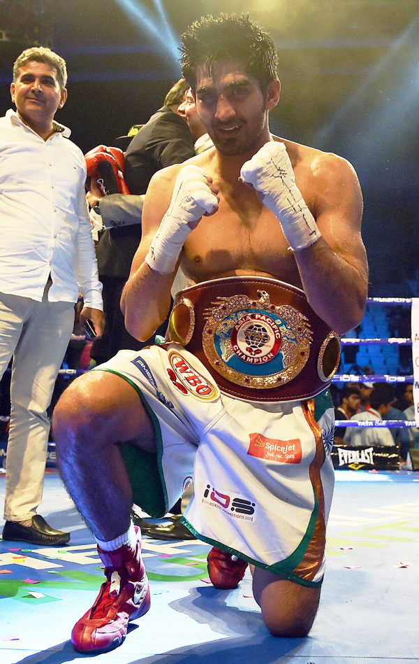 Star Indian boxer Vijender Singh celebrates after beating Australia's Kerry Hope and won the WBO Asia Pacific Super Middleweight Championship at Thyagaraj Sports Complex in New Delhi on Saturday
