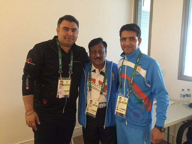 Indian shooters Gagan Narang (left), and Chain Singh (right) with India's Chef de Mission Rakesh Gupta at the Olympic Village in Rio de Janeiro