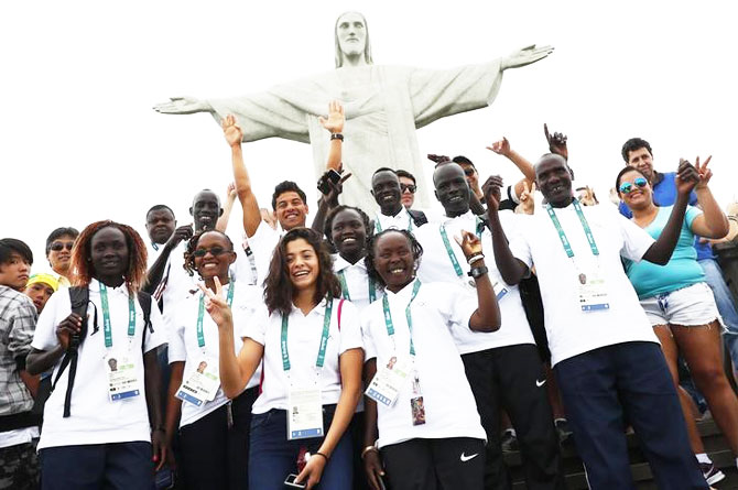 Members of the Olympic refugee team pose in front of Christ the Redeemer