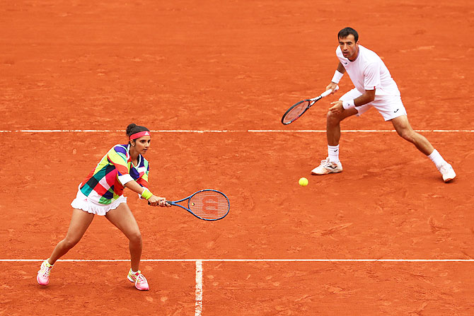 Sania Mirza and Ivan Dodig in action during the mixed doubles final